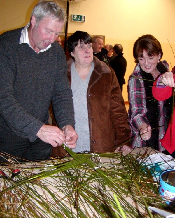 Making St. Bridget's crosses in Magheroarty Community Centre