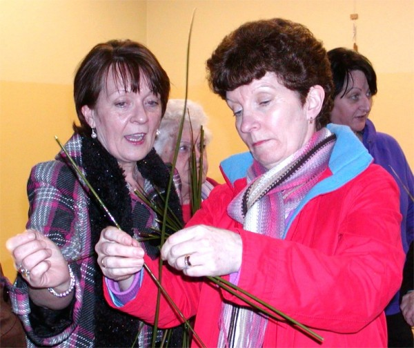 Sharing tips on cross making in Magheroarty Community Centre